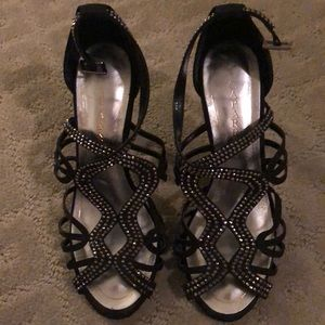 """Strappy, crystal-studded silhouette. 5.5"""" heel"""